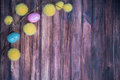 Easter background with colored eggs, branches and copy space