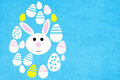 Easter background with colored eggs and rabbit