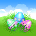 Easter background and colorful Easter eggs in green grass