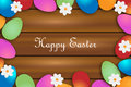 Easter background colorful eggs and flowers on wood Royalty Free Stock Image