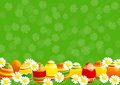 Easter background eggs and white camomiles on green Royalty Free Stock Photo
