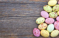 Easter background small spotted pastel color easter eggs wooden rustic table Royalty Free Stock Photography