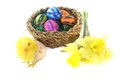 Easter basket with chick and eggs on a light background Royalty Free Stock Image
