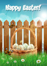 Easter basket with easter eggs on a field with picket fence vector illustration Stock Photos