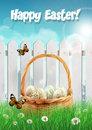 Easter basket with easter eggs on a field with white picket fence card vector illustration Stock Images