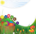 Easter basket on a green meadow Royalty Free Stock Photo