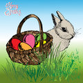 Easter basket with rabbit eggs and the bunny in the grass Stock Photography