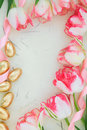 Easter border background with tulip flowers gold eggs over handmade paper Royalty Free Stock Photos