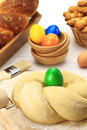 Easter bread dough sweet with multicolored eggs Royalty Free Stock Photo