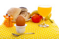 Easter breakfast with egg, bread, fruits and drinks Royalty Free Stock Photo