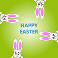 Easter bunnies on green background