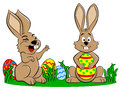 Easter bunnies playing with easter eggs vector illustration of on white background Stock Photos