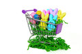 Easter bunnies in shopping cart colorful and eggs isolated on white Stock Photo
