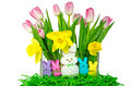 Easter bunnies with spring flowers bunny candies daffodils and pink tulips in glass vase Stock Photography