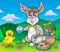 Easter bunny artist and chicken Stock Images