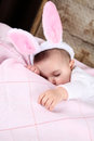 Easter bunny baby sleeping wearing fluffy ears Royalty Free Stock Images