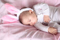 Easter bunny baby sleeping wearing fluffy ears Royalty Free Stock Photography