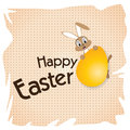Easter bunny with Big gold egg on a white paper. Happy Easter Day. Royalty Free Stock Photo