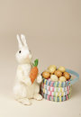Easter bunny with carrot and eggs studio seasonal or holiday image Stock Image