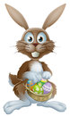 Easter bunny with chocolate eggs an rabbit holding a basket of decorated painted Royalty Free Stock Photography