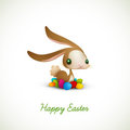 Easter Bunny with Colored Eggs Stock Images