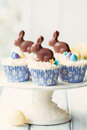 Easter bunny cupcakes decorated with chocolate bunnies Royalty Free Stock Photos