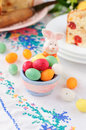 Easter bunny egg holder filled with colorful spotted egg shaped candies shallow dof copy space for your text Stock Image
