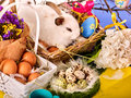 Easter bunny and egg. Rabbit among spring holiday flowers. Royalty Free Stock Photo