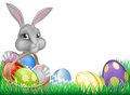 Easter bunny and eggs basket cartoon white with a full of decorated chocolate in a field Stock Photography