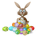 Easter bunny with eggs basket an rabbit a of decorated painted chocolate Stock Photos