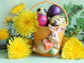 Easter bunny eggs and flowers stock photos holiday card with yellow dandelions on green background Stock Images