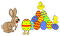 Easter bunny finds a running easter egg vector illustration of an Royalty Free Stock Image