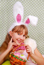 Easter bunny girl with basket Royalty Free Stock Photos