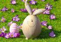 Easter bunny on green grass funny with egg and some crocus flowers Royalty Free Stock Images