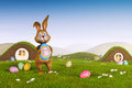 Easter bunny holding an egg with the words happy easter a cute Stock Images
