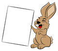 Easter bunny holding a sign in hand vector illustration of an Royalty Free Stock Photography