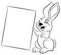 Easter bunny holding a sign in hand vector illustration of an Royalty Free Stock Photo