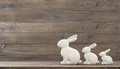 Easter bunny over wooden background rustic retro style toned picture Royalty Free Stock Image