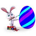 Easter bunny with paint Stock Photo