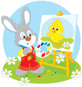 Easter bunny painter little rabbit draws a small chick Royalty Free Stock Photos
