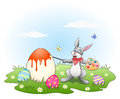 Easter bunny painting colored eggs handdrawn illustration of an coloring during spring christian holidays Royalty Free Stock Photos
