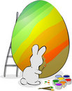 Easter bunny is painting eggs. Stock Photography