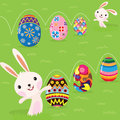 Easter bunny playful with painted eggs