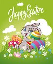 Easter bunny rabbit on the meadow with Easter eggs chocolate Royalty Free Stock Photo