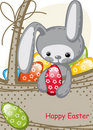 Easter bunny sitting in a basket Royalty Free Stock Image