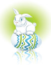 Easter bunny sitting on an egg Stock Image