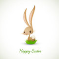 Easter Bunny Sitting in Grass Royalty Free Stock Images