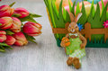 Easter bunny with tulips and eggs on the vntage wooden Royalty Free Stock Photo