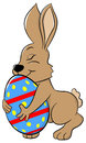 Easter bunny who loves his egg vector illustration of a Stock Image
