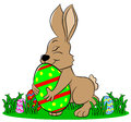 Easter bunny who loves his egg vector illustration of a Stock Photography